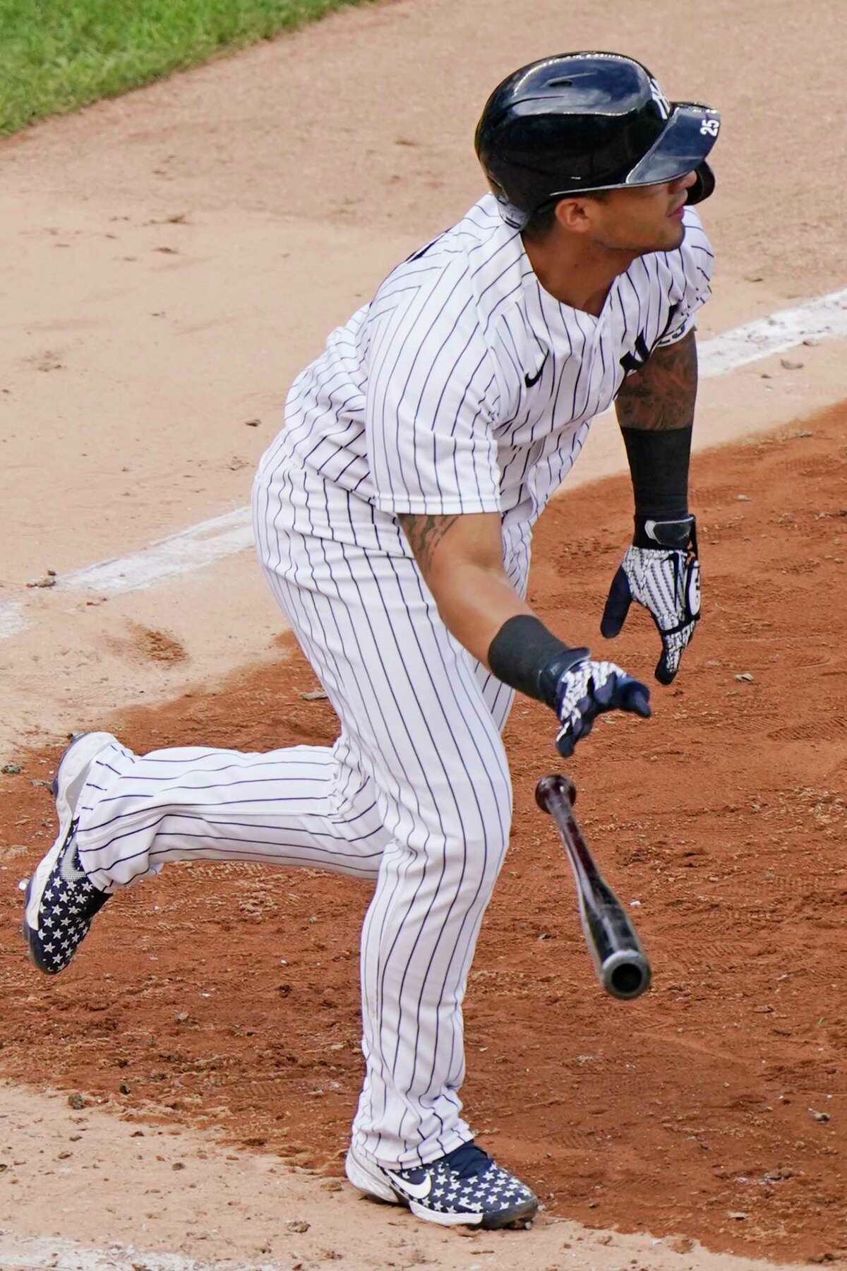 New York Yankees shortstop Gleyber Torres drops the bat as he watches his two-run double in the eighth inning of a baseball game against the Baltimore Orioles, Sunday, Sept. 13, 2020, at Yankee Stadium in New York. (AP Photo/Kathy Willens)