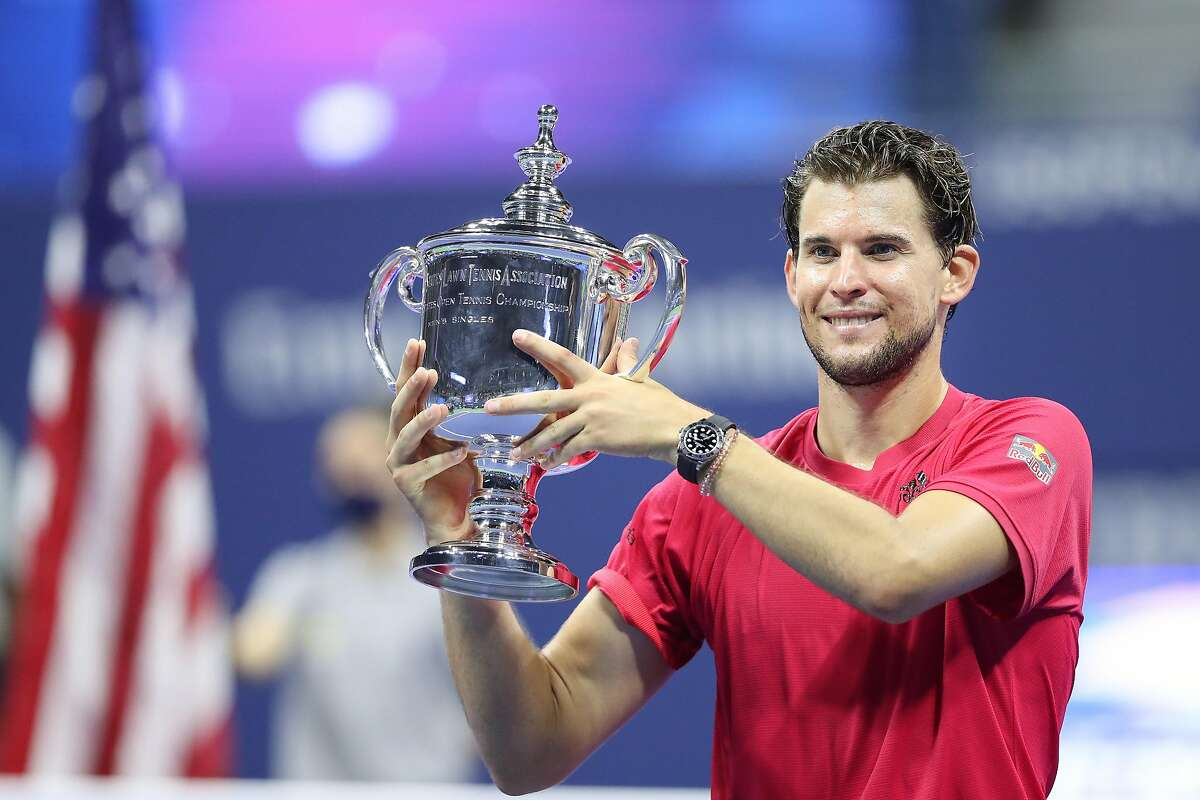NEW YORK, NEW YORK - SEPTEMBER 13: Dominic Thiem of Austria celebrates with championship trophy after winning in a tie-breaker during his Men's Singles final match against Alexander Zverev of Germany on Day Fourteen of the 2020 US Open at the USTA Billie Jean King National Tennis Center on September 13, 2020 in the Queens borough of New York City. (Photo by Matthew Stockman/Getty Images)