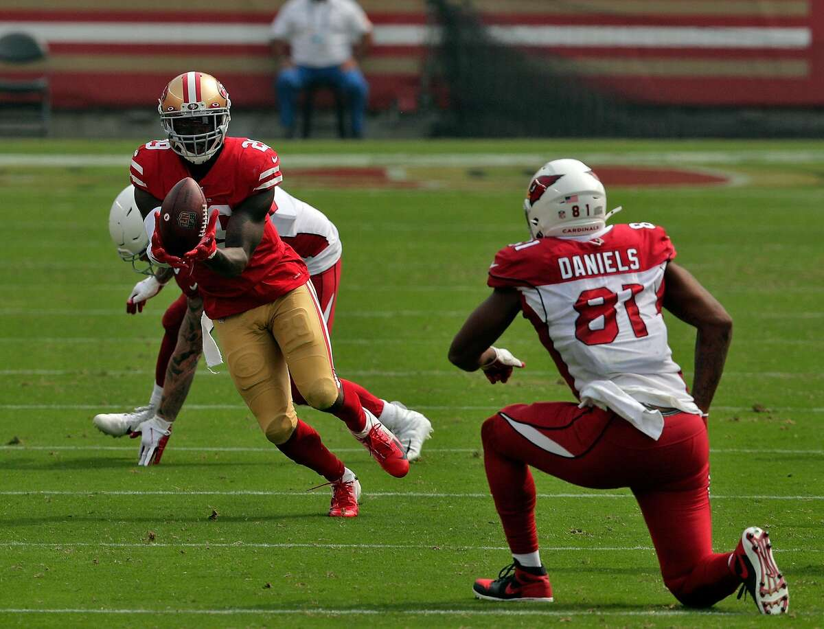 Jaquiski Tartt (29) intercepts a Kyler Murray (1) pass that was tipped by Dre Greenlaw (57) In the first half as the San Francisco 49ers played the Arizona Cardinals at Levi's Stadium in Santa Clara, Calif., on Sunday, September 13, 2020.