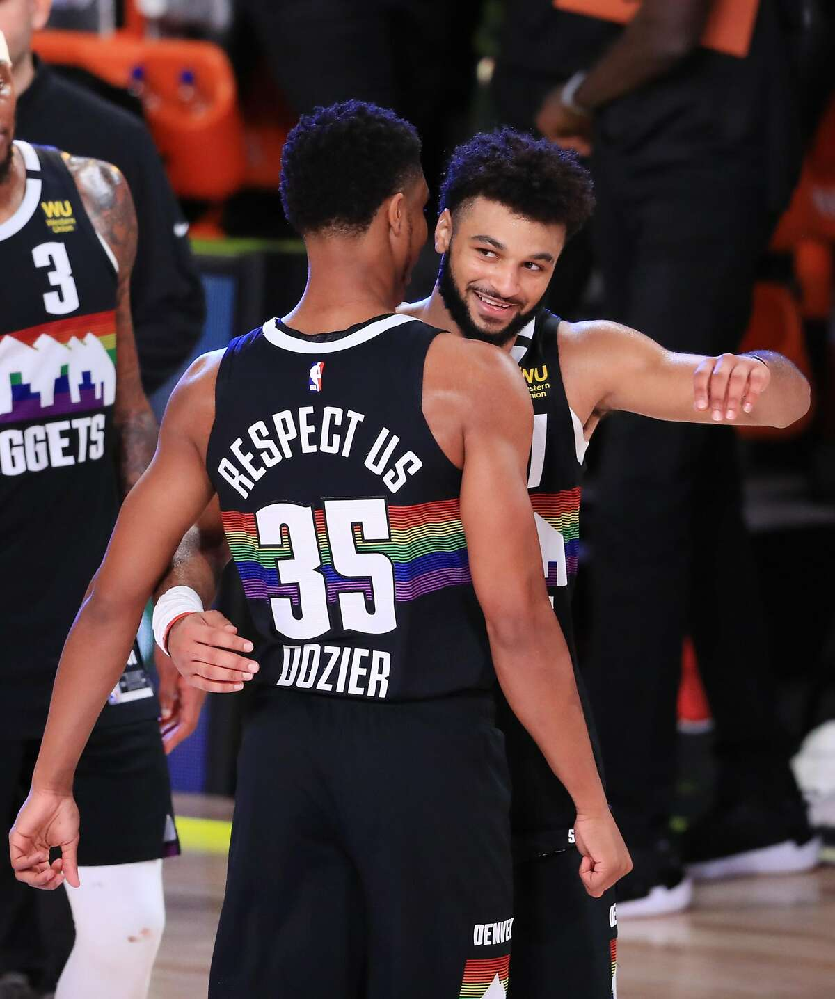 LAKE BUENA VISTA, FLORIDA - SEPTEMBER 13: Jamal Murray #27 of the Denver Nuggets reacts with PJ Dozier #35 of the Denver Nuggets during the fourth quarter against the LA Clippers in Game Six of the Western Conference Second Round during the 2020 NBA Playoffs at AdventHealth Arena at the ESPN Wide World Of Sports Complex on September 12, 2020 in Lake Buena Vista, Florida. NOTE TO USER: User expressly acknowledges and agrees that, by downloading and or using this photograph, User is consenting to the terms and conditions of the Getty Images License Agreement. (Photo by Michael Reaves/Getty Images)