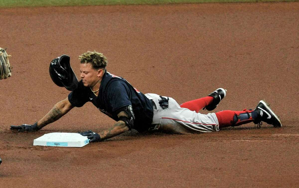 Boston Red Sox's Yairo Munoz slides into second base with a double off Tampa Bay Rays starter Charlie Morton during the first inning of a baseball game Sunday, Sept. 13, 2020, in St. Petersburg, Fla. (AP Photo/Steve Nesius)