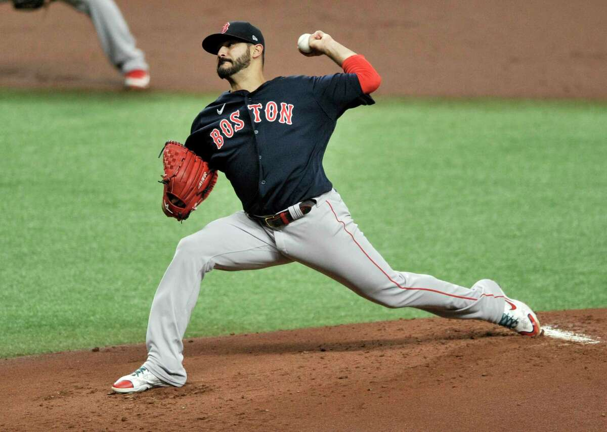 Boston Red Sox starter Martin Perez pitches against the Tampa Bay Rays during the first inning of a baseball game Sunday, Sept. 13, 2020, in St. Petersburg, Fla. (AP Photo/Steve Nesius)