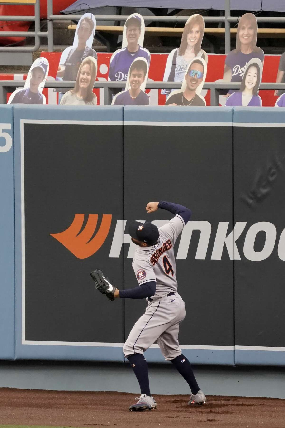 Houston Astros right fielder George Springer reacts as he misses the ball for a two-run home run by Los Angeles Dodgers' Mookie Betts during the fifth inning of a baseball game in Los Angeles, Sunday, Sept. 13, 2020. (AP Photo/Alex Gallardo)