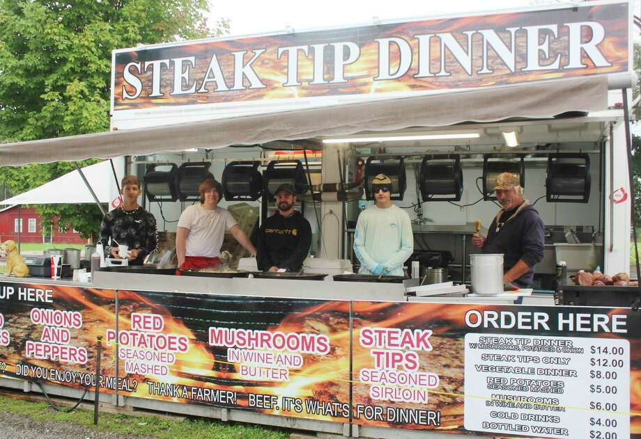 Steak vendors prepared meals for locals during a fair food event Saturday. Other food served included ice cream, cotton candy, lemonade, funnel cakes and more. More photos, 2A. (Pioneer photo/Catherine Sweeney)