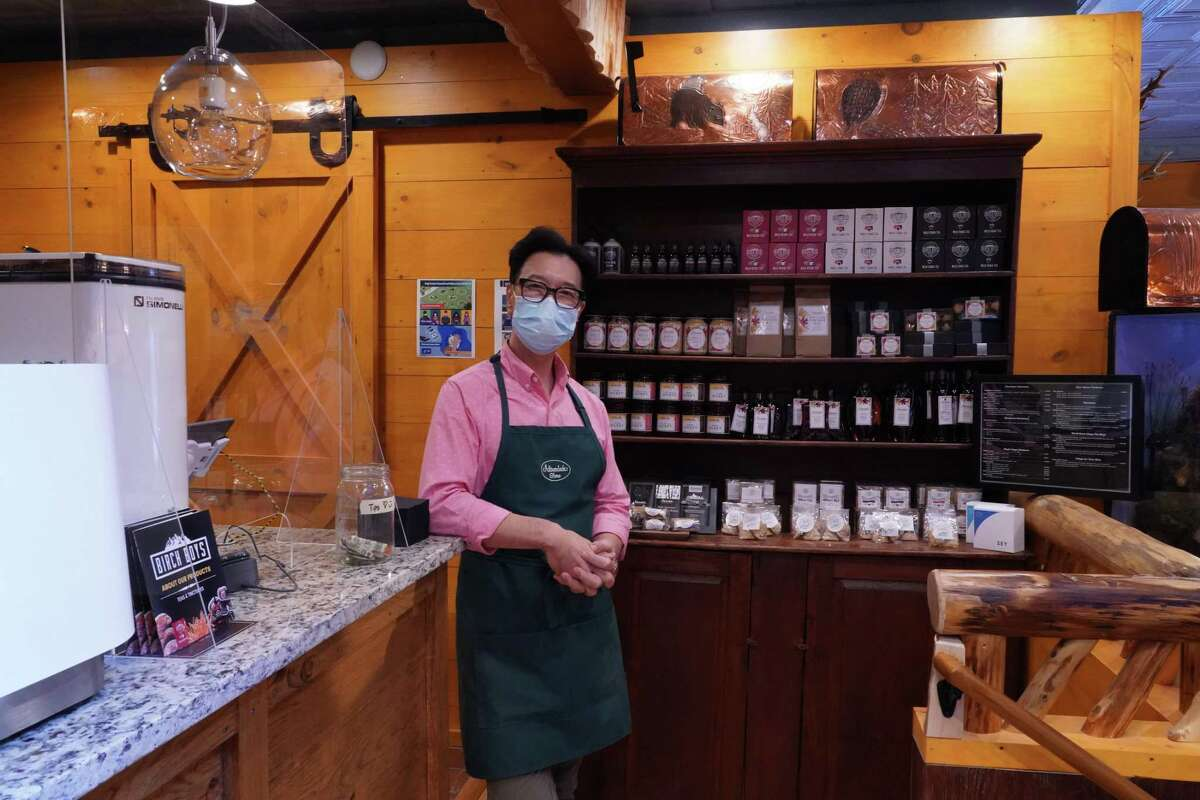 Steve Shin encourages people to bring in their dogs and drink coffee from the Adirondack store's Tall Pine coffee bar while browsing the many themed items that can be found in the New Canaan store, ranging from chaga teas, engraved glass, antler chandeliers and antiques.
