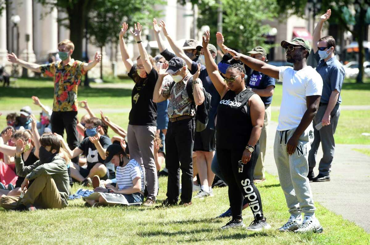 People gather for a protest on the New Haven Green in June