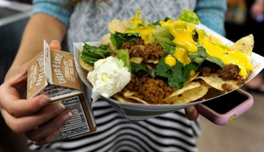 Taco salad and chocolate milk were this student's lunch at New Fairfield Middle School in May 2015. Photo: Carol Kaliff / Hearst Connecticut Media