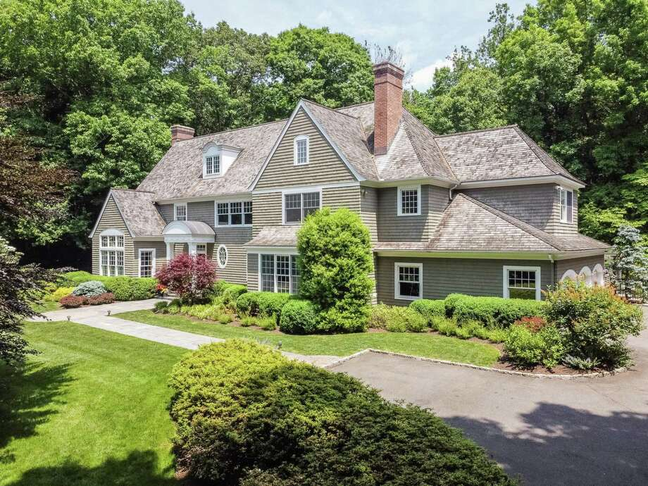 The custom-built colonial house at 52 Charcoal Hill Road sits on a private two-acre property in the Coleytown neighborhood . Photo: 360 Properties And Associated Photographer(s) / © 360 Properties LLC and Associated Photographer(s)
