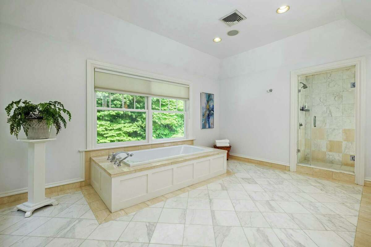 The marble master bath is large and luxurious.