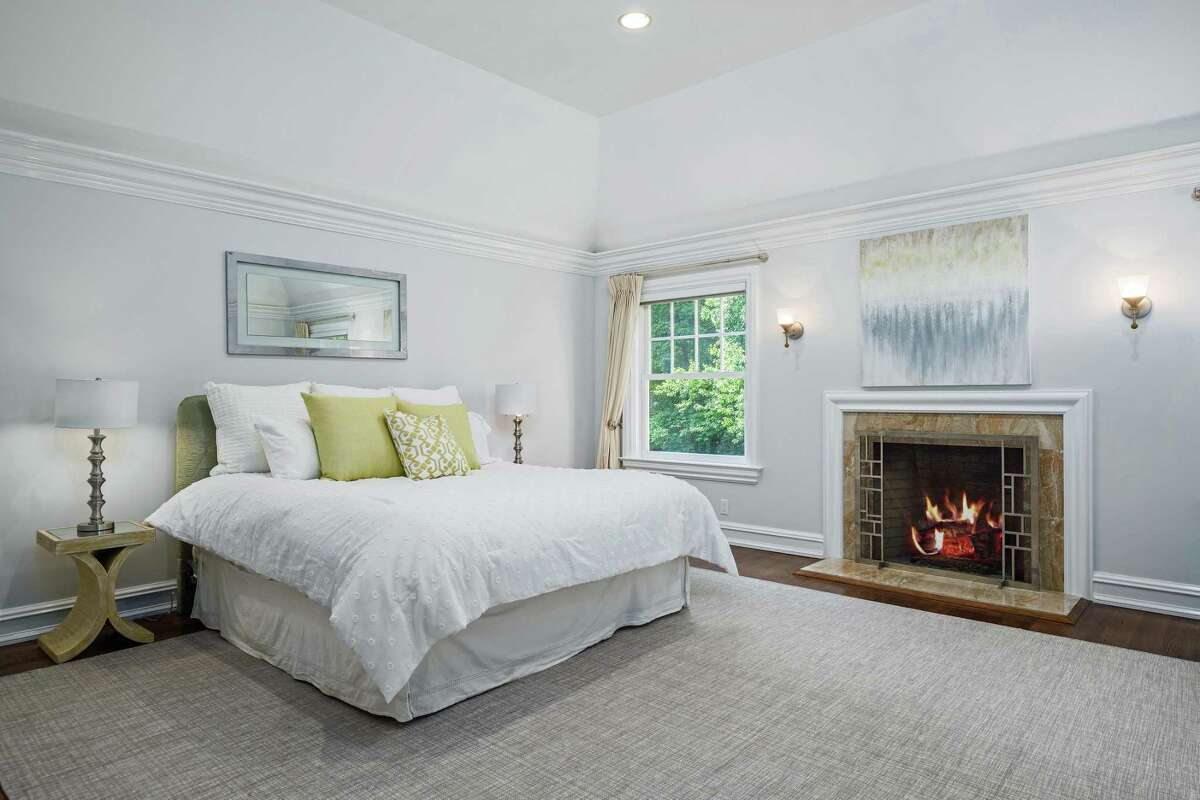 The master bedroom suite has a gas log fireplace, two closets and a spacious bath.