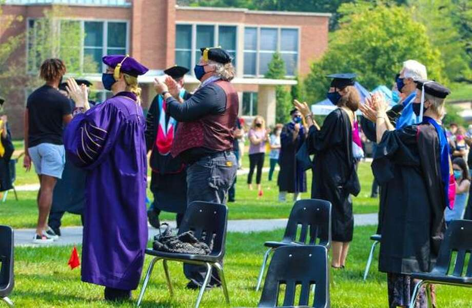 Principia College faculty and well-wishers applaud as the college's new students walked to the chapel for convocation Friday.