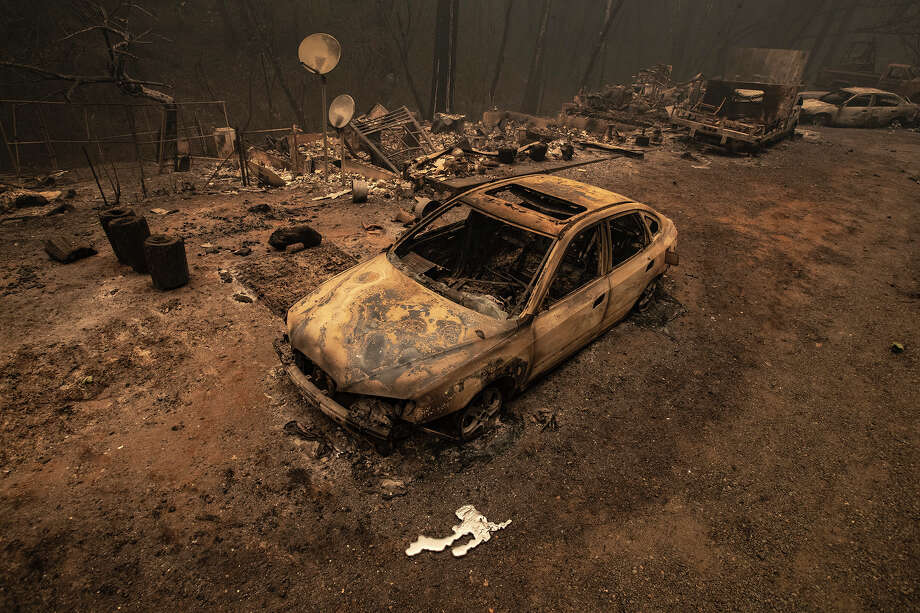 A burned vehicle sits in front of a home on Oro Quincy Hwy. destroyed in the North Complex fire on Friday, Sept. 11, 2020 in Berry Creek, CA. Photo: Brian Van Der Brug/Los Angeles Times Via Getty Imag / 2020 Los Angeles Times
