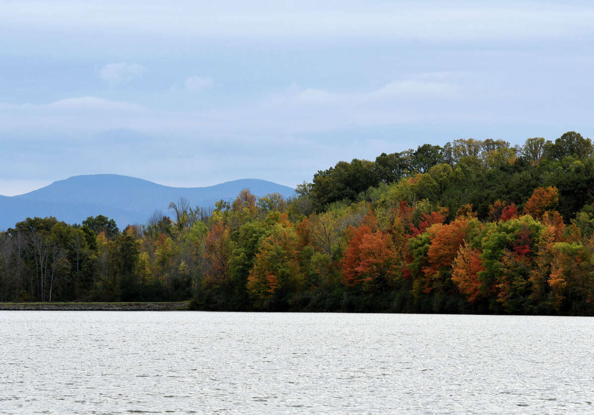 Fall colors and the Catskill Mountains are seen across Basic Creek Reservoir on Monday, Sept. 30, 2019, in Westerlo, N.Y. (Will Waldron/Times Union)