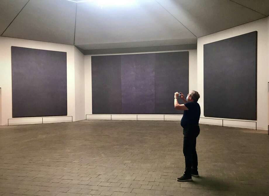 Lighting designer George Sexton photographs the Rothko Chapel on June 19, 2020, during one of his last visits to tweak the new baffle system. Photo: Molly Glentzer / Houston Chronicle
