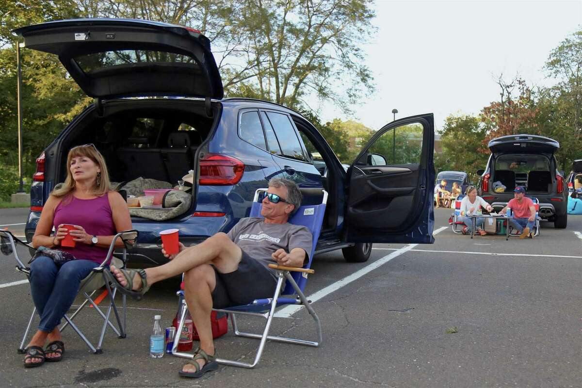 Jane and Brad Purcell of Fairfield relax before the show at the Terrapin concert from the Supper & Soul series at the Imperial Lot on Friday, Sept. 11, 2020, in Westport, Conn.