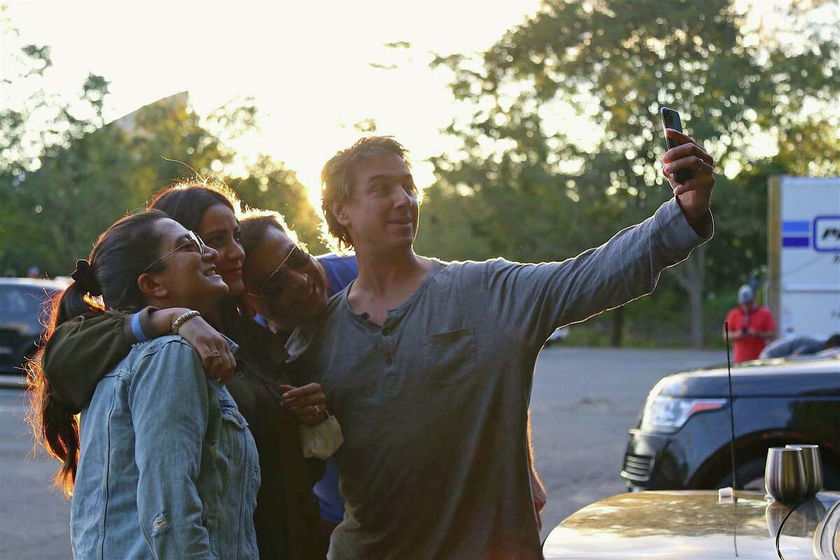 Friends grab a picture together, including, from left, Samreen Verma of Fairfield, Adriana Nassi of Norwalk, Rahul Verma, and David Nassi, at the Terrapin concert from the Supper & Soul series at the Imperial Lot on Friday, Sept. 11, 2020, in Westport, Conn.