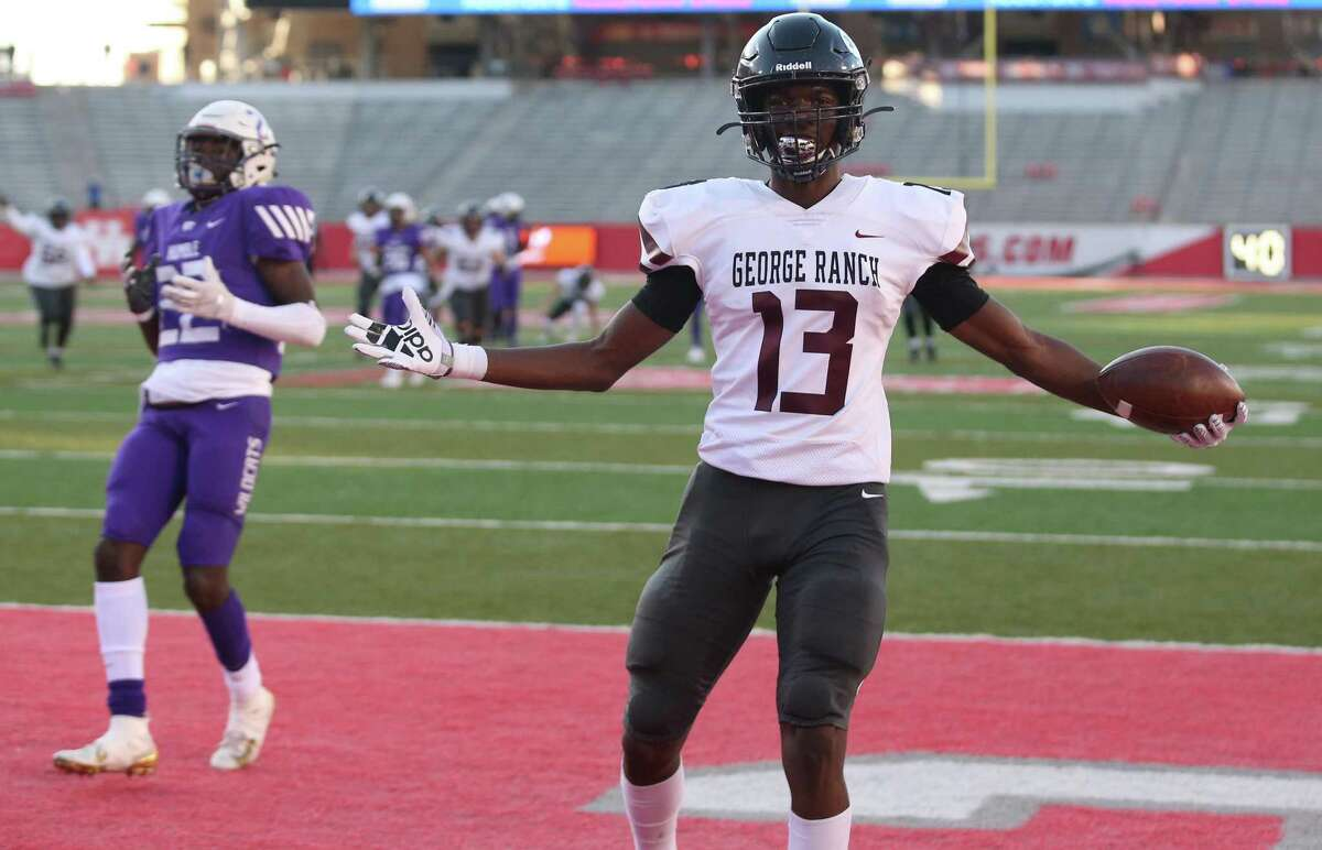George Ranch Longhorns wide receiver Javon Gipson (13) celebrates his touchdown reception against the Humble Wildcats in the first half in a high school playoff football game on November 23, 2019 at TDECU Stadium in Houston, TX.