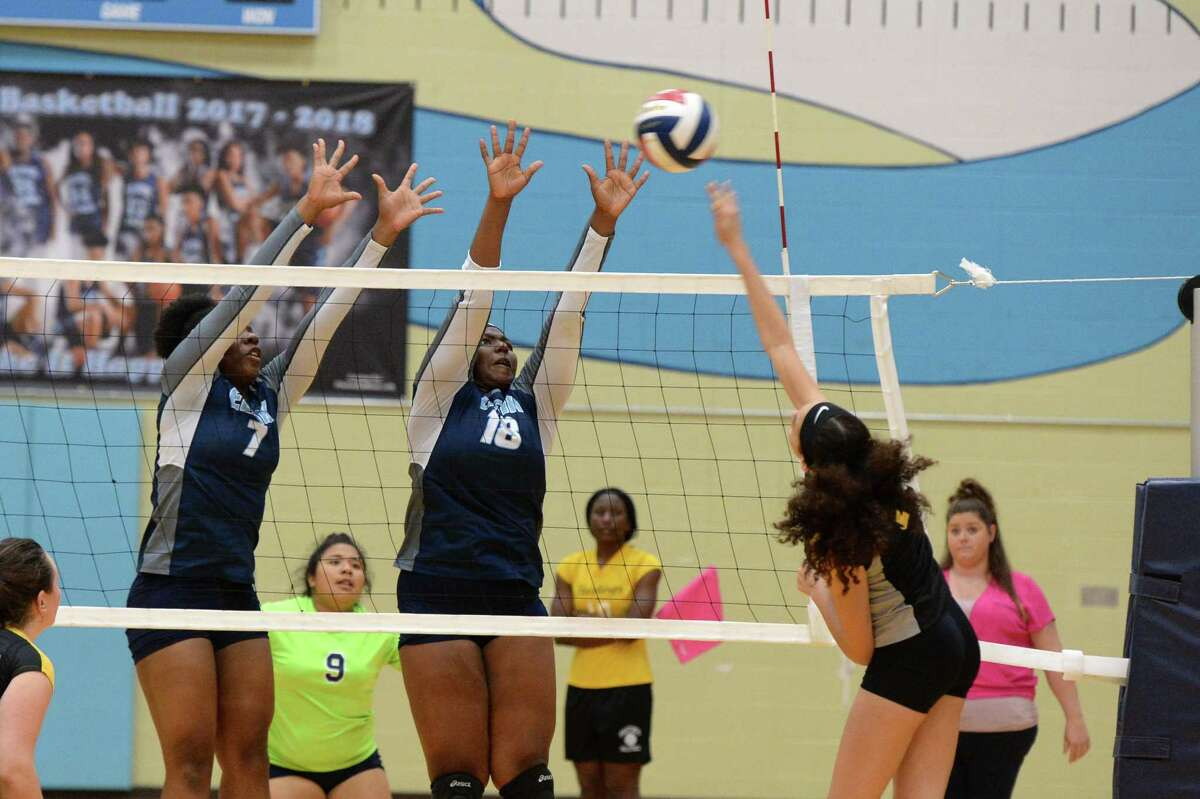 Joyceline Onwuemeka (7) and Lauren Collier (18) of Elsik attempt to block a shot being made by Iliyana Riley (6) of Hastings in the second set of a high school volleyball match between the Elsik Rams and the Hastings Bears on October 2, 2018 at Elsik HS, Alief, TX.
