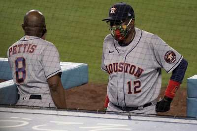 Houston Astros manager Dusty Baker (12) talks with third base coach Gary Pettis (8) during the eighth inning of a baseball game against the Los Angeles Dodgers in Los Angeles, Sunday, Sept. 13, 2020. (AP Photo/Alex Gallardo)