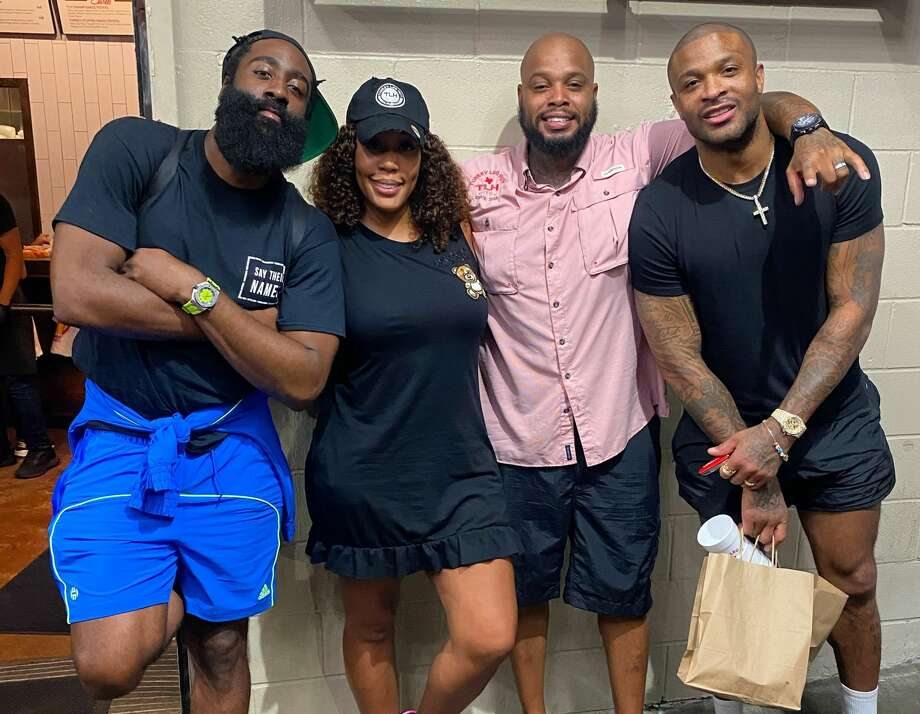 Count James Harden and P.J. Tucker among the celebrity fans of Turkey Leg Hut. Pictured: James Harden, owner Nakia Price, owner Lynn Price and P.J. Tucker. Photo: Courtesy