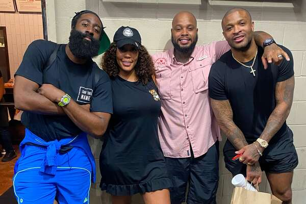 Count James Harden and P.J. Tucker among the celebrity fans of Turkey Leg Hut. Pictured: James Harden, owner Nakia Price, owner Lynn Price and P.J. Tucker.