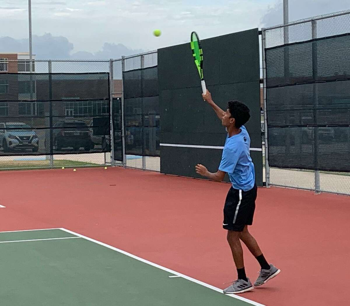 Paetow's Omar Maisur serves during a doubles match against Brenham in the season opener for both teams Sept. 8 at Paetow High School. Maisur and teammate Jonathan Mejia won 6-2, 6-4.
