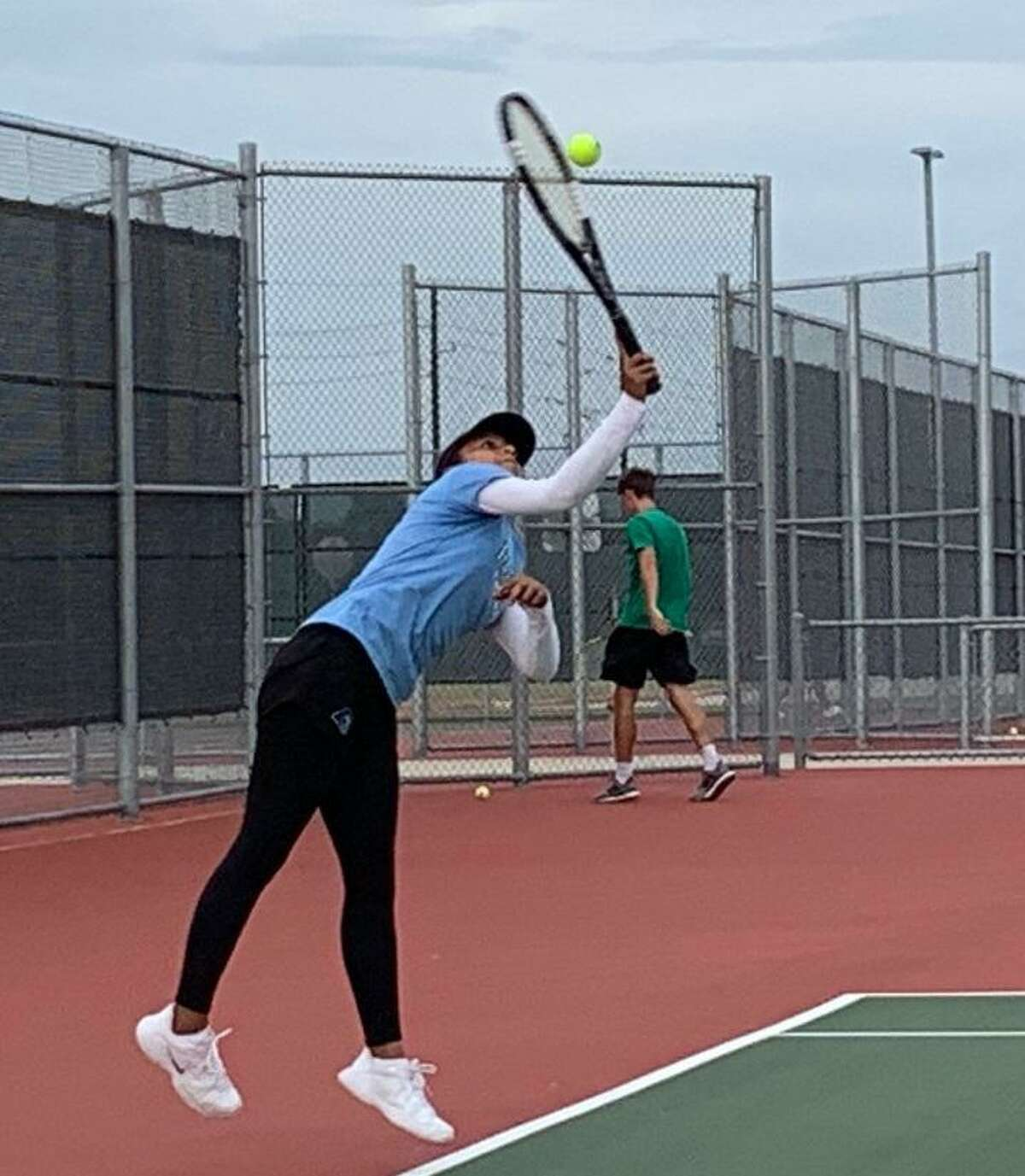 Paetow's Crystal Marcia serves during a singles match against Brenham in a District 19-5A team tennis dual Sept. 8 at Paetow High School. Marcia won her match 6-4, 6-2, contributing to a 17-2 victory for the Panthers.