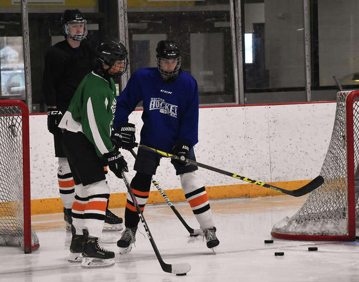 Members of the EHS ice hockey team skate through a drill during practice inside the East Alton Ice Arena in July. The Tigers will be moving their top team back to the MVCHA for the upcoming season due to the coronavirus.