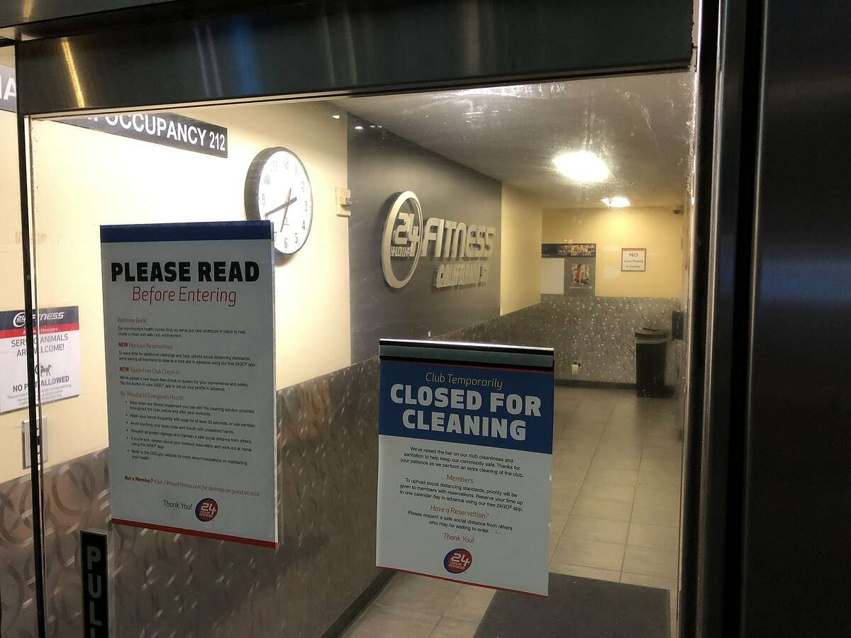 24 Hour Fitness is one of the first business to reopen after shutting down since mid-March shelter-in-place order due to Covid-19. Members wait for doors to open at 7 a.m. on Monday, sept. 14, 2020 in San Francisco, Calif.