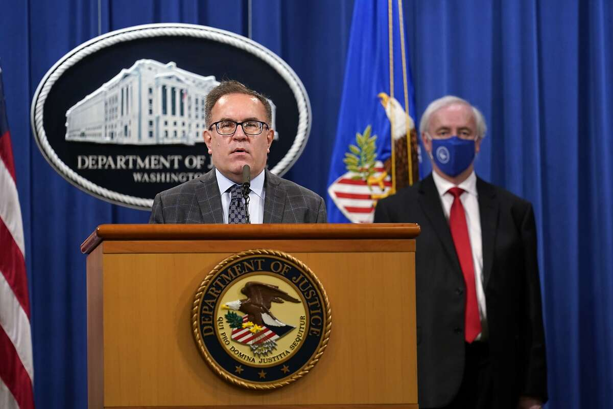 Environmental Protection Agency (EPA) Administrator Andrew Wheeler speaks, left, as Deputy Attorney General Jeffrey Rosen and looks on, during a news conference at the Justice Department in Washington, Monday, Sept. 14, 2020. Automakers Daimler AG and subsidiary Mercedes-Benz USA have agreed to pay $1.5 billion to the U.S. government and California state regulators to resolve emissions cheating allegations. (AP Photo/Susan Walsh, Pool)