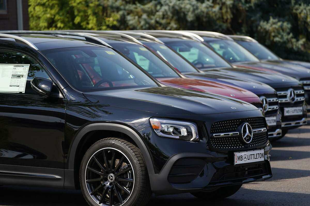 A long row of unsold 2020 GLB250 sports-utility vehicles sits at a Mercedes Benz dealership Sunday, Sept. 6, 2020, in Littleton, Colo. (AP Photo/David Zalubowski)