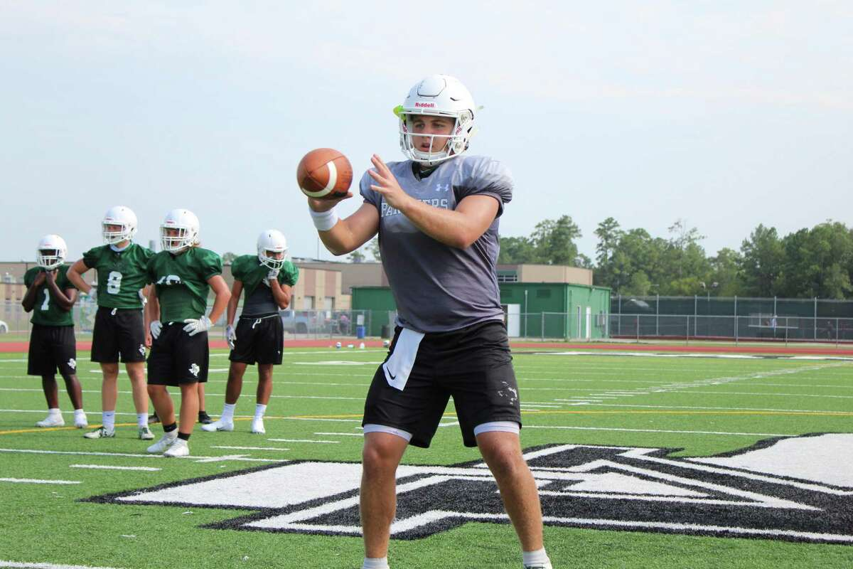 Kingwood Park senior quarterback Hudson Dezelle throwing the ball in drills during practice on Friday.