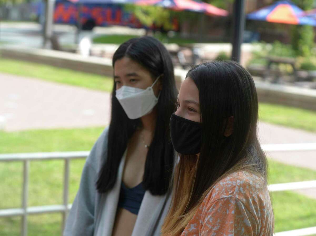 Freshman Julie Hoff, right, and Seungmin Lee, both of Shelton, talk about attending In-person classes at Western Connecticut State University starting Monday morning. September 14, 2020, in Danbury, Conn.