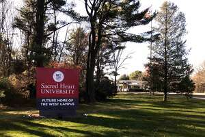The GE sign at the property on Easton Turnpike in Fairfield, Conn. now displays a sign for Sacred Heart University, future home of the west campus. It was announced on Monday, Nov. 21, 2016 that General Electric sold the campus for $31.5M deal to SHU.