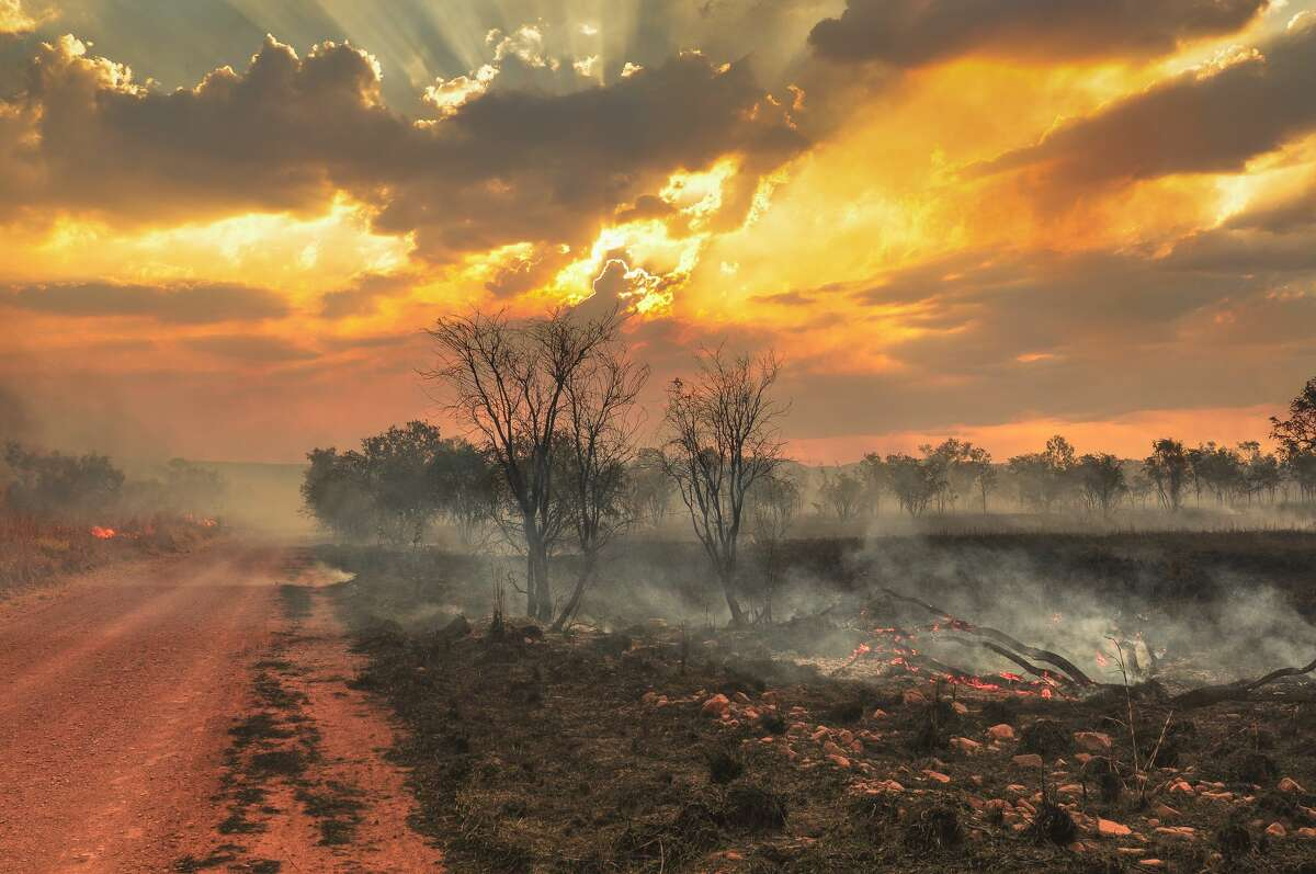 FILE - Australian outback bush fires. The largest wildfire in modern history was the Black Friday Bushfire in Australia's Victoria State in January 1939, burning some 4.9 million acres and claiming 71 lives.