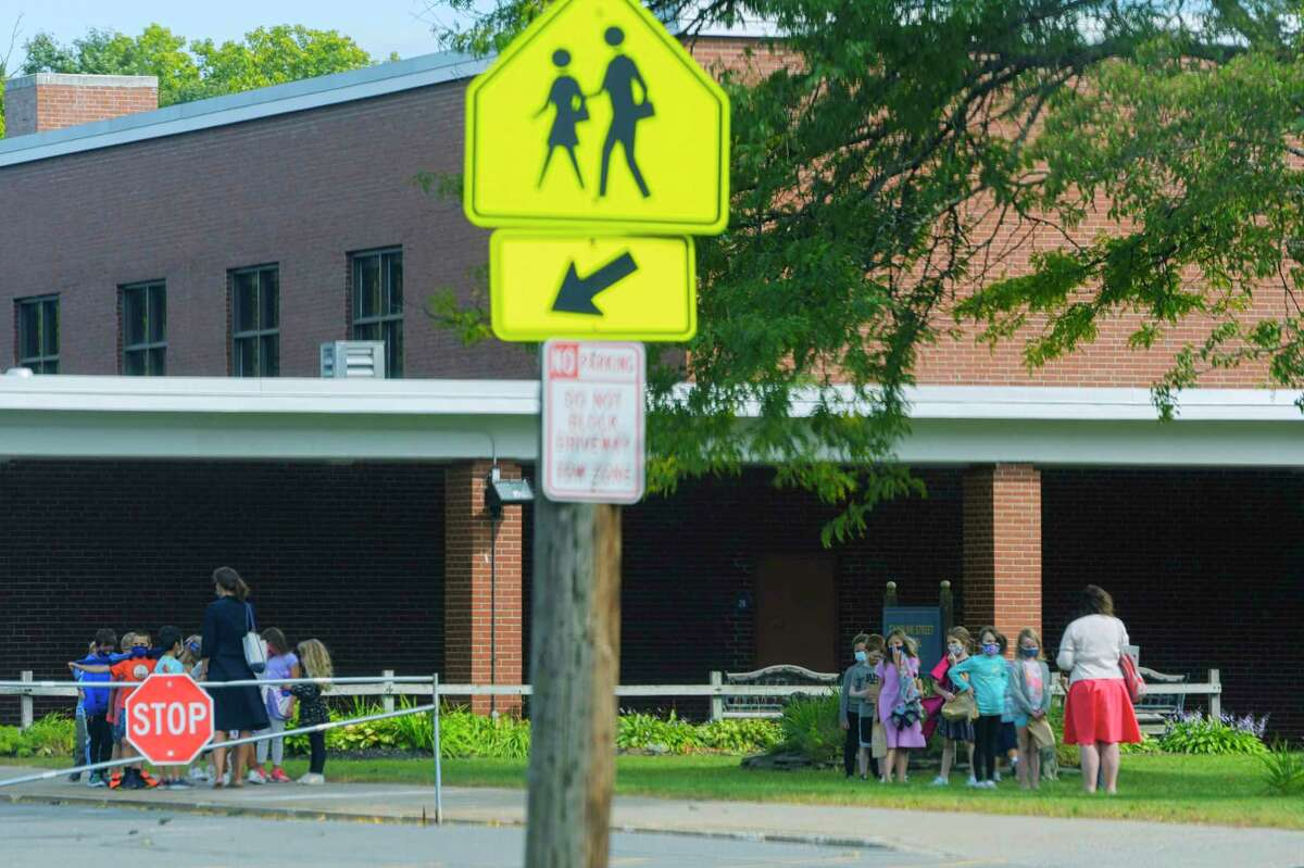 Children line up after playing outside in the front of the Caroline Street School on Monday, Sept. 14, 2020, in Saratoga Springs, N.Y. (Paul Buckowski/Times Union)