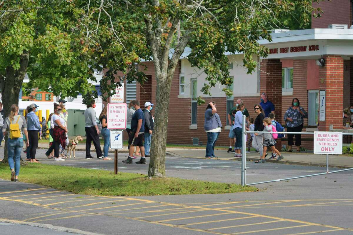 Parents line up to collect their children at the end of the school day at the Caroline Street School on Monday, Sept. 14, 2020, in Saratoga Springs, N.Y. (Paul Buckowski/Times Union)