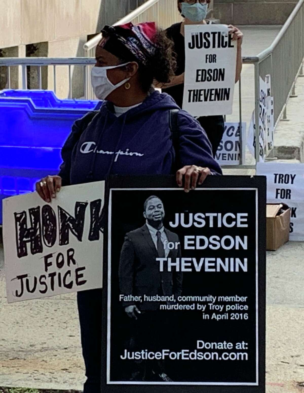 Protesters hold signs outside Rensselaer County Court on Monday. Opening statements begin Tuesday in the trial of former Rensselaer County District Attorney Joel Abelove, who is charged with first-degree perjury, a felony, and charges of official misconduct, a misdemeanor, in connection with his handling of the 2016 fatal police shooting of Edson Thevenin