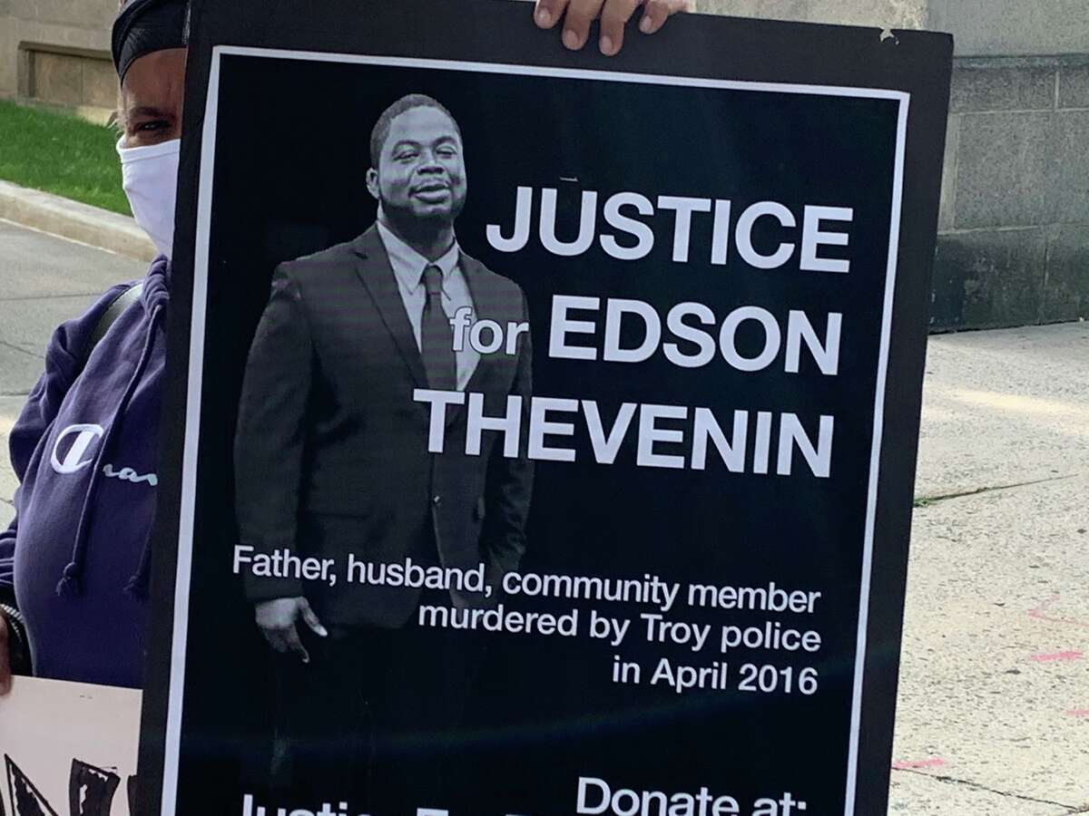 Protesters hold signs outside Rensselaer County Court on Monday. Opening statements begin Tuesday in trial of former Rensselaer County District Attorney Joel Abelove, who is charged with first-degree perjury, a felony, and charges of official misconduct, a misdemeanor, in connection with his handling of the 2016 fatal police shooting of Edson Thevenin