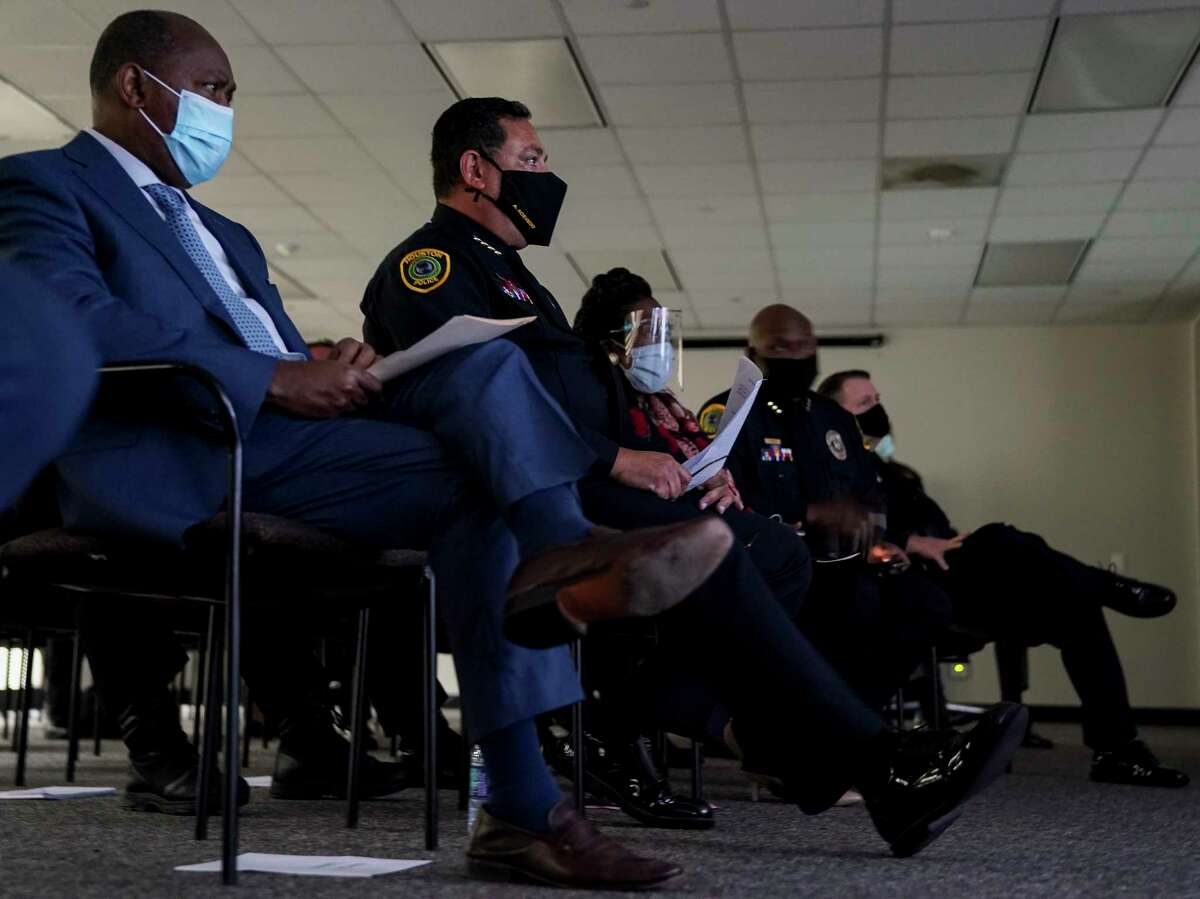 Mayor Sylvester Turner, left, and Houston Police Chief Art Acevedo watch the footage of the April 21 police shooting of Nicolas Chavez during a press conference last week. The city fired four officers for their roles in the shooting.