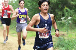 Jersey's Cole Martinez (front) leads CM's Evan Zobrist (middle) and Highland's Josh Loeh into the wooded portion of the cross country course at Triad High School in the Pre-MVC Meet on Saturday in Troy.