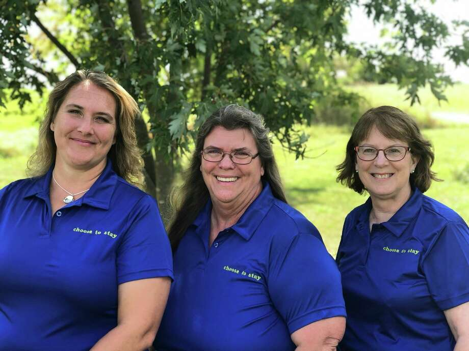 Featured are Choose to Stay incorporaters Michelle Lewis, Teresa Korpal, and Lucy Kebler. The organization will be hosting its second annual Remembrance Walk in an effort to bring awareness to mental health and suicide, while remembering those participants have lost. (Courtesy photo)
