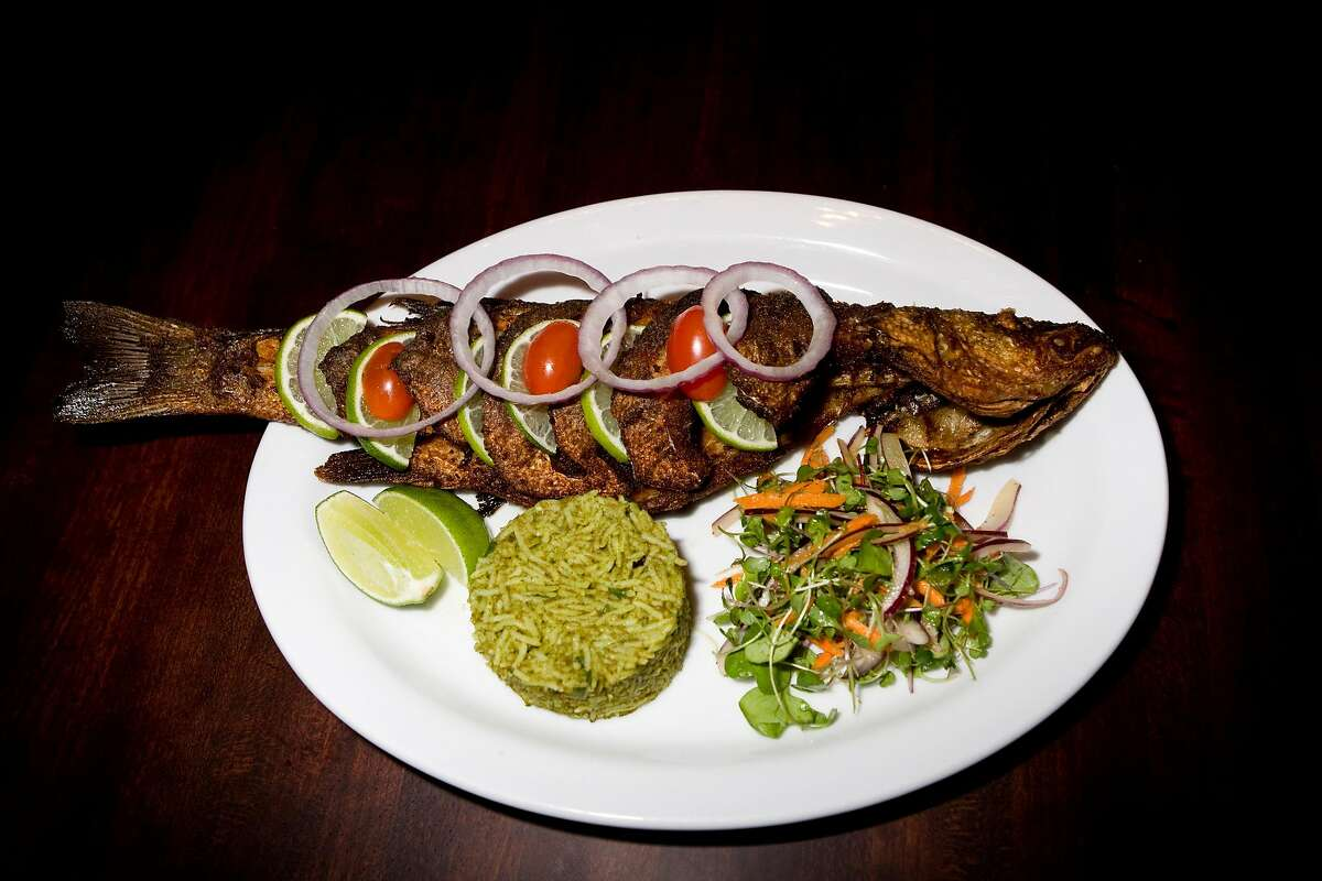 A whole fried black bass with cilantro rice and organic spring greens at the new location of Dosa on Fillmore Street in San Francisco , Calif., on Wednesday, November 26, 2008.