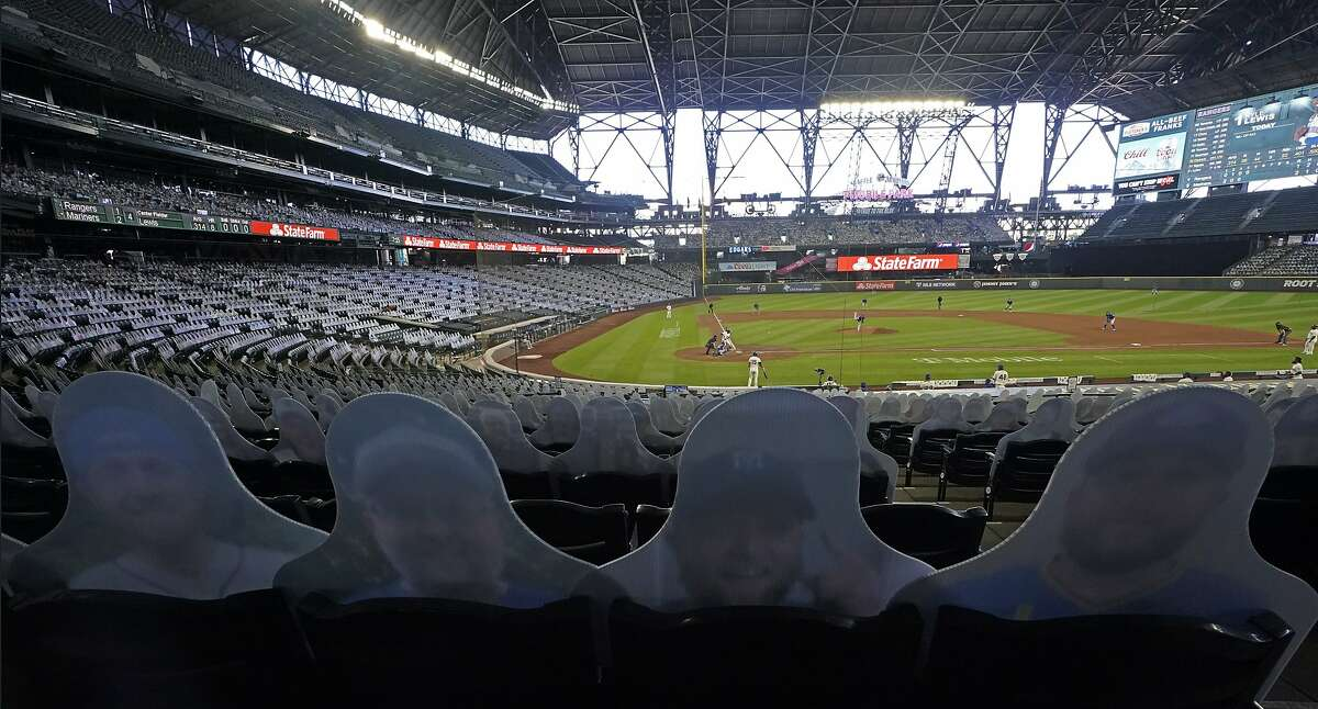 Seats are shown with cutout photos of fans during a baseball game at T-Mobile Park, Sunday, Sept. 6, 2020, in Seattle. Due to the coronavirus pandemic, games are being played without fans in attendance, but the Mariners allowed people to purchase photos to place in the seats, and if a foul ball makes it to a seat, the team will mail it to the fan whose photo is there. (AP Photo/Ted S. Warren)