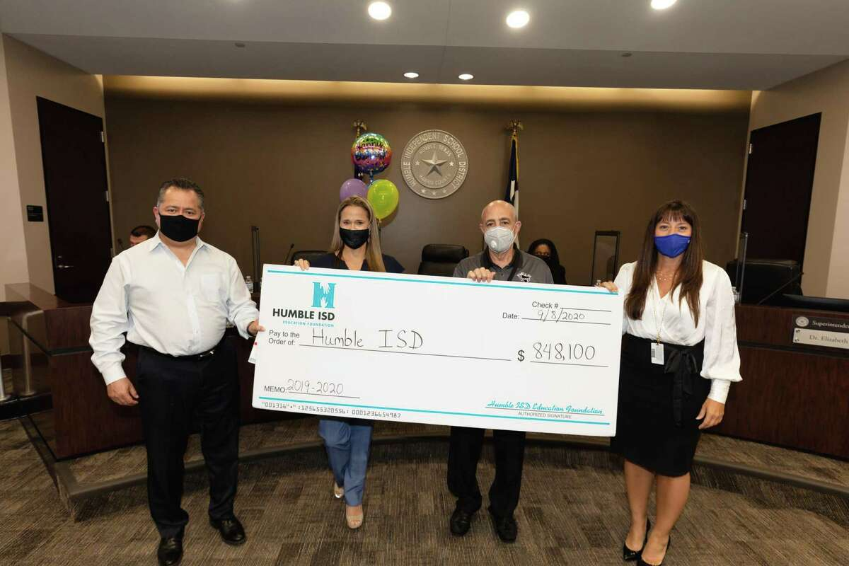 The Humble ISD Education Foundation reported over $1.5 million were raised in the 2019-2020 school year. They presented a check to Humble ISD of $848,100 at the Sept. 8 monthly board meeting. From left to right: Jim Carranza, Incoming Chairperson, Humble ISD Education Foundation Board of Directors; India Loth, Outgoing Chairperson, Humble ISD Education Foundation Board of Directors; Robert Scarfo, School Board Liaison 2019-2020; Dr. Elizabeth Fagen, Superintendent, Humble ISD.