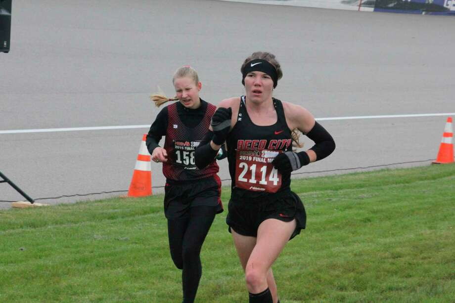 Reed City's Abbigail Kiaunis heads to the finish line at a cross country state meet. (Pioneer file photo)