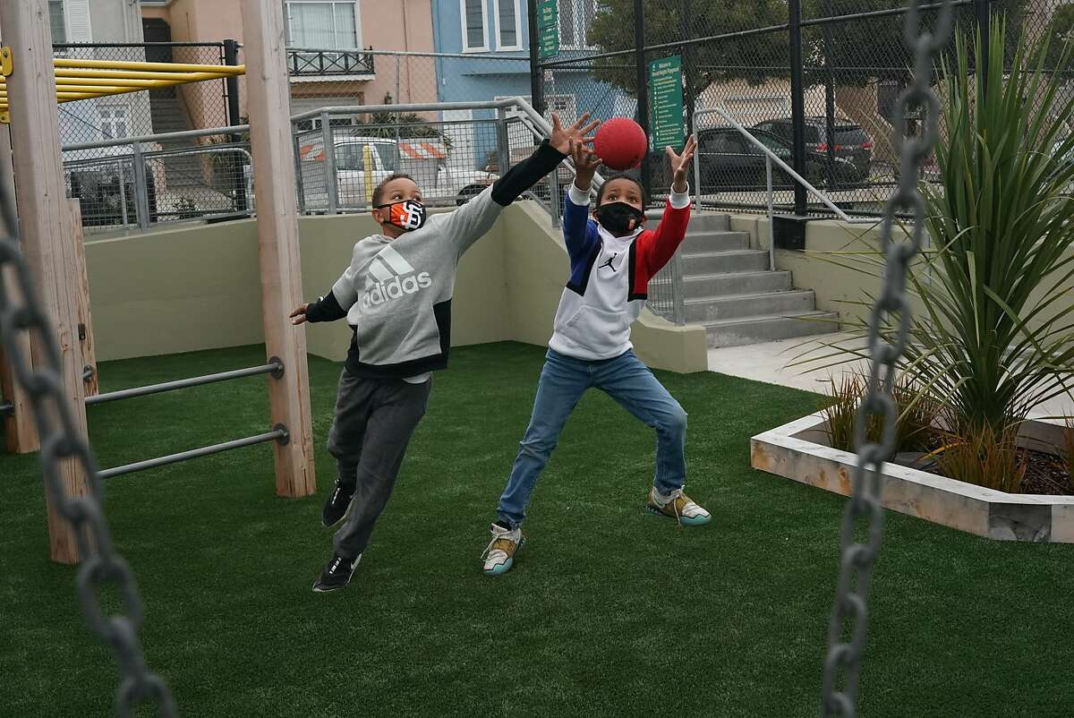 James Mayberry, 9, left, and Isaiah Howard, 9, go for a ball during a short break while attending a SF hub for kids for academic support and supervision - -a substitute for school at this point by a company called Youth 1st. on Monday, Sept. 14, 2020 in San Francisco, Calif.