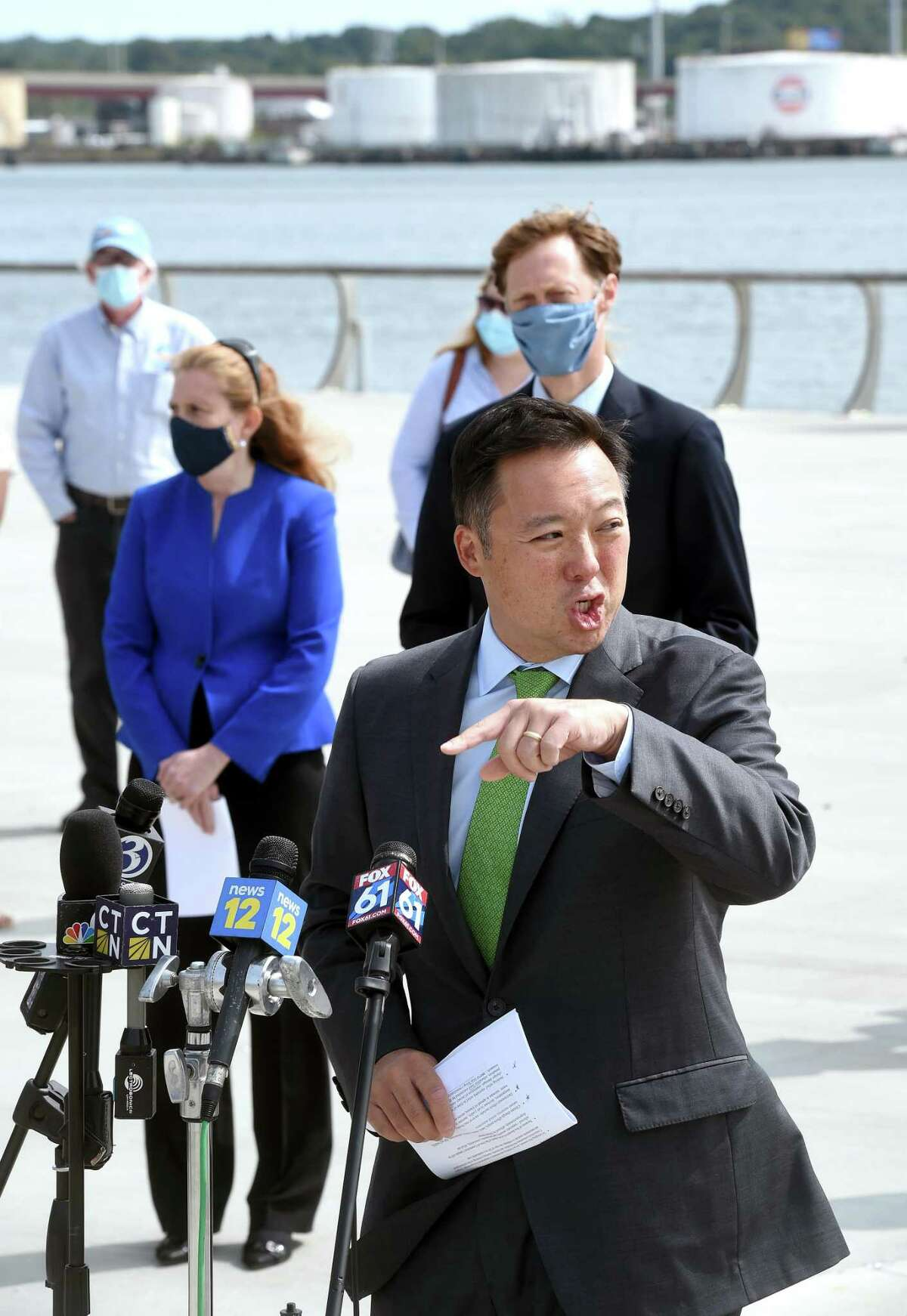 Connecticut Attorney General William Tong announces a suit against ExxonMobil concerning its alleged deception relating to information about climate change, outside the Canal Dock Boathouse in New Haven Sept. 14, 2020.