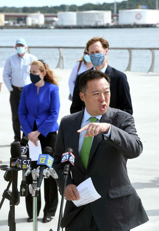 Connecticut Attorney General William Tong announces a suit against ExxonMobil concerning its alleged deception relating to information about climate change, outside  the Canal Dock Boathouse in New Haven  Sept. 14, 2020. Photo: Arnold Gold / Hearst Connecticut Media / New Haven Register
