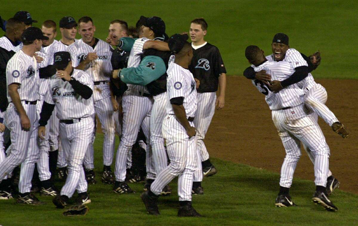 The Ravens' Keith Gordon lifts up teammate Jermaine Clark, right, as they celebrate beating the Reading Phillies to win the 2000 Eastern League Championship Series in West Haven.